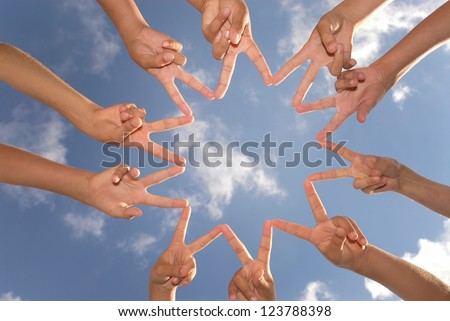 Hands together against the sky