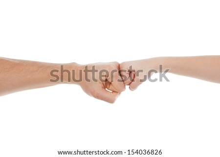 Hands together. Close-up of child and adult fists touching each other while isolated on white - stock photo