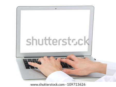 Hands typing on keyboard computer laptop with blank copy-space screen  in an office at a workplace isolated on a white background - stock photo