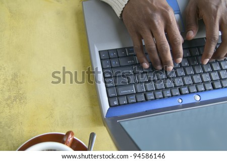 Hands typing on laptop - stock photo
