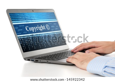 hands typing on laptop. Copyright message concept - stock photo