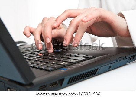 hands typing on the notebooks keyboard