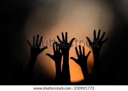 hands up at sunset  - stock photo