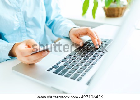 Hands using laptop and credit card. Online shopping concept