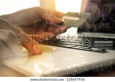 hands using laptop and holding credit card with digital layer effect diagram as Online shopping concept - stock photo