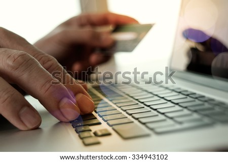 hands using laptop and holding credit card with social media diagram as Online shopping concept - stock photo