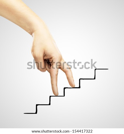 hands walking on drawing rung - stock photo