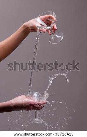 hands with a glass of water and effuse