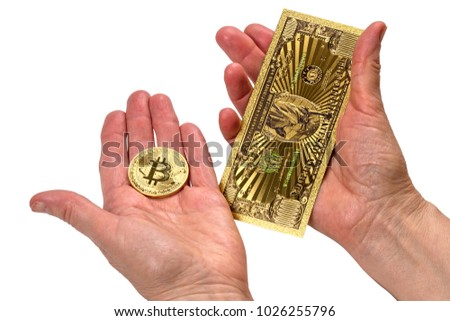 Hands with American Gold Banknote and bitcoin isolated on a black background