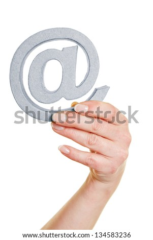 Hands with an at sign as symbol for communication - stock photo