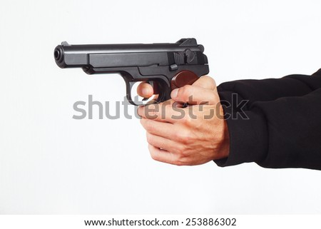 Hands with army pistol on a white background - stock photo