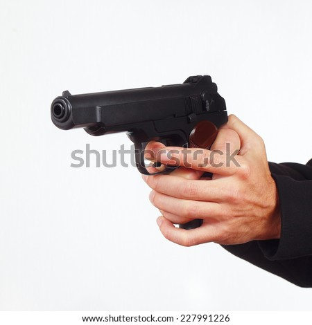 Hands with automatic handgun on a white background - stock photo