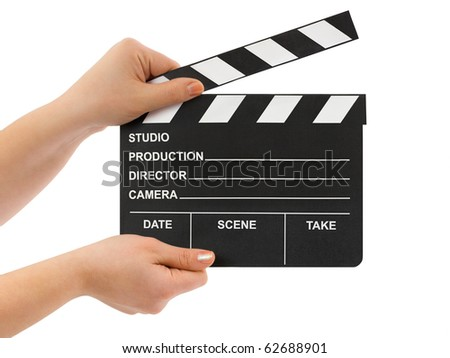 Hands with cinema clapboard isolated on white background - stock photo