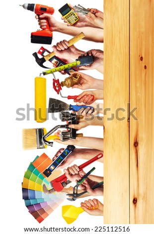 Hands with construction tools. House renovation background. - stock photo
