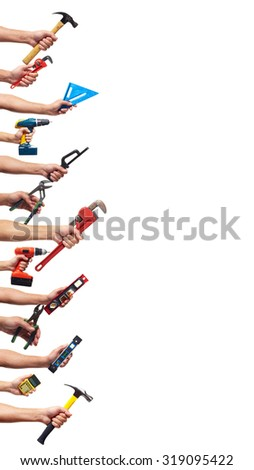 Hands with construction tools isolated on white. Renovation background. - stock photo