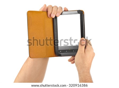 Hands with E-book reader isolated on white background - stock photo