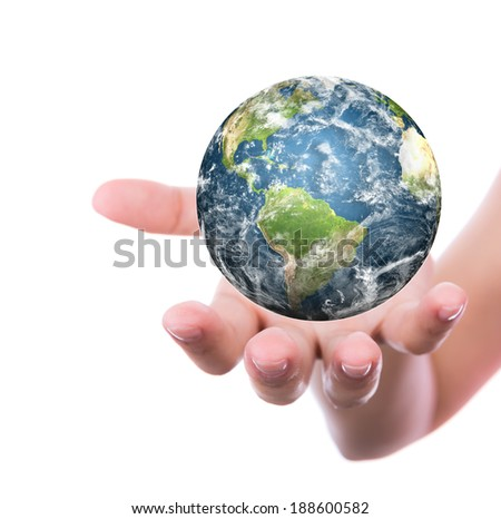 Hands with earth (Elements of this image furnished by NASA) - stock photo