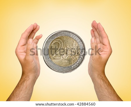 Hands with euro coin