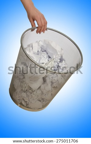 Hands with garbage bin with paper - stock photo