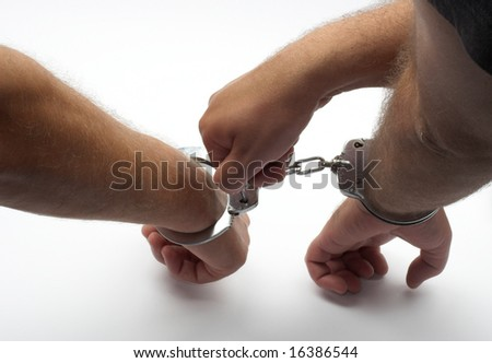 hands with handcuffs close up - stock photo