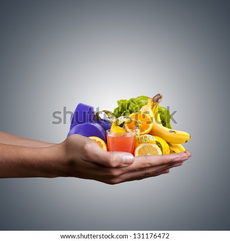 hands with healthy, natural foods, juice and weights for exercise - stock photo