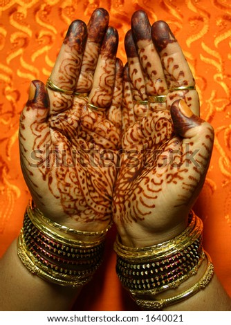 Hands with Henna design - stock photo