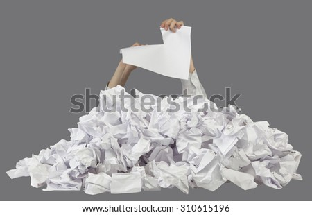 Hands with lacerated paper reaches out from crumpled papers isolated on gray background