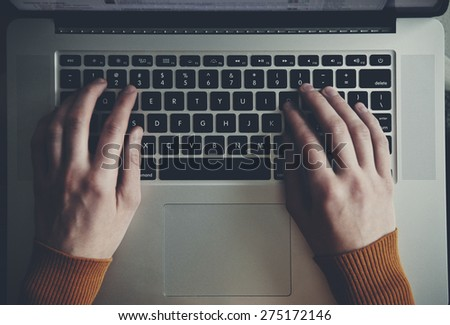 hands with laptop typing - stock photo