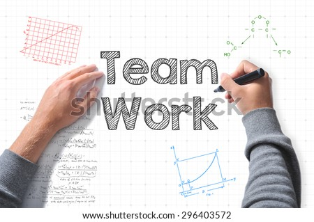 hands with marker writing Team Work - stock photo