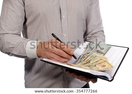 hands with money, dollars in notepad, pen