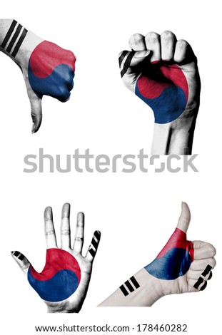 hands with multiple gestures (open palm, closed fist, thumbs up and down) with South Korea flag painted isolated on white - stock photo