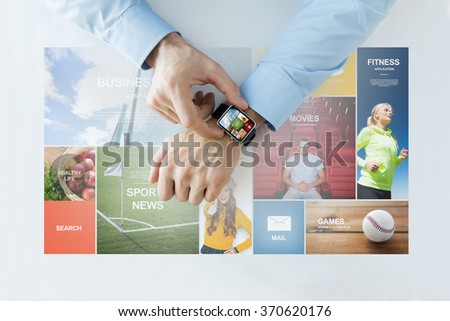 hands with news web pages on smart watch - stock photo