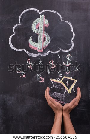 Hands with painted on chalkboard dollar signs and purse - stock photo