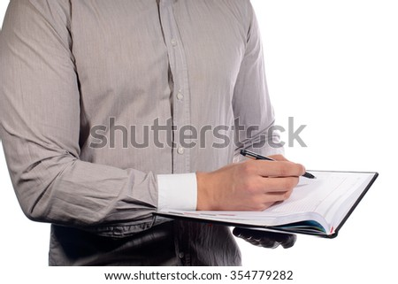 hands with pen and notepad