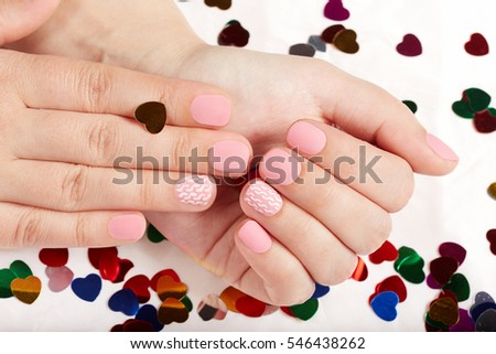Hands with pink matte manicured nails