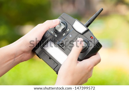 Hands with RC controller - stock photo