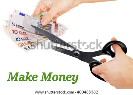 Hands with scissors cutting Euro banknotes, isolated on white - stock photo