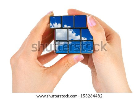 Hands with sky puzzle isolated on white background - stock photo