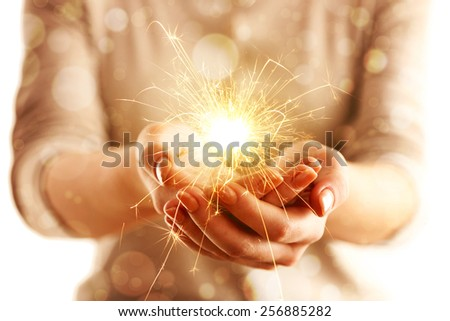 Hands with sparkler light isolated on white - stock photo