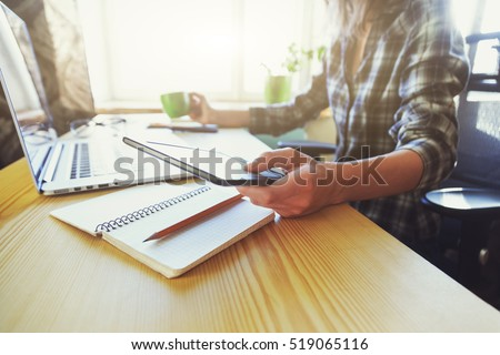 hands with tablet, coffee and laptop at table