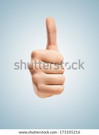 hands with thumbs up isolated on blue - stock photo
