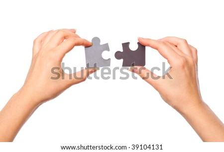 Hands with two puzzles. Isolated on white background - stock photo