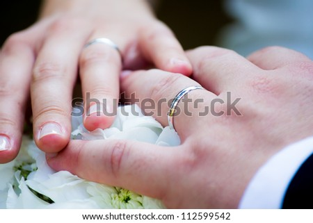 Hands with wedding ring - stock photo