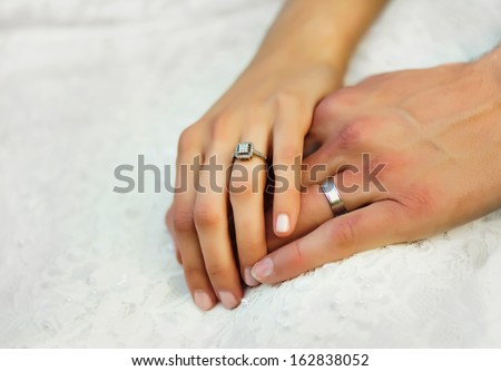Hands with wedding rings - stock photo