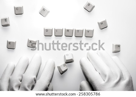 Hands with white gloves typesetting dirty with white keys on white background.