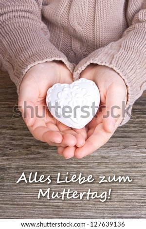Hands with white heart and lettering mother`s day/ mother`s day/heart - stock photo
