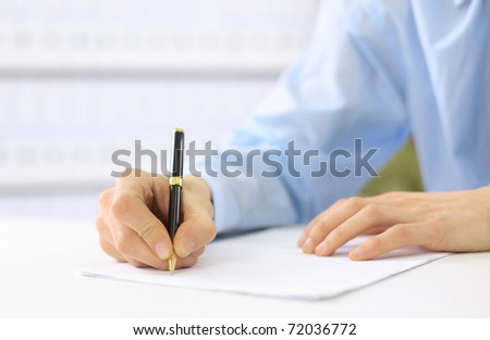 Hands writing on a paper - stock photo