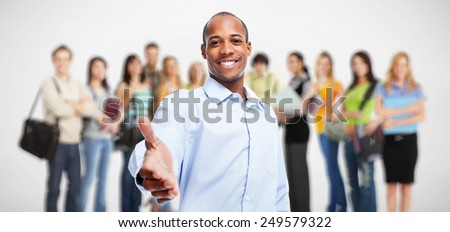 Handshake. African-American businessman and group of workers - stock photo