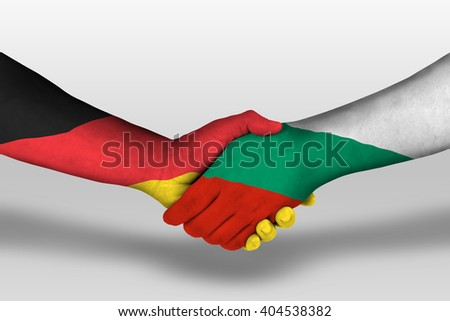 Handshake between bulgaria and germany flags painted on hands, illustration with clipping path.