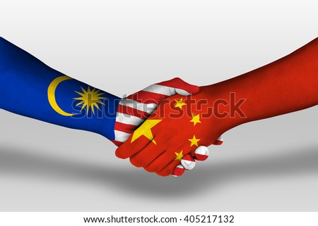 Handshake between china and malaysia flags painted on hands, illustration with clipping path.